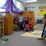 Teacher Sonya reading during freeplay